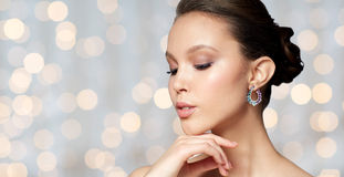 Close up of beautiful woman face with earring Royalty Free Stock Photos