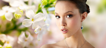 Close up of beautiful woman face with earring stock images