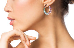 Close up of beautiful woman face with earring Stock Photos