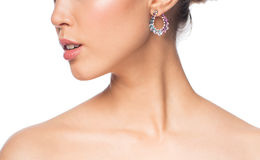 Close up of beautiful woman face with earring Royalty Free Stock Images