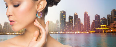 Close up of beautiful woman face with earring Stock Image