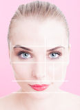 Close-up of beautiful woman face with makeup and divided lines Stock Images