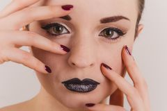 Close up of beautiful woman face portrait with tinsel makeup stock photography