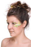Close up of beautiful woman with feather make up Stock Photo