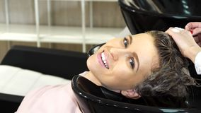 Close up of a beautiful woman getting her hair washed at the hairdresser salon royalty free stock images