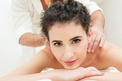 Close-up of beautiful woman getting massage in a spa center Royalty Free Stock Photo