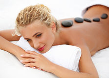 Close-up of a Beautiful Woman Getting Spa Treatment. Stone Massage Stock Images