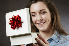 Close up of beautiful woman with gift. Isolated Royalty Free Stock Images