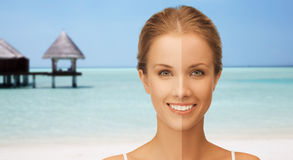 Close up of beautiful woman with half face tanned. People, suntan, travel and summer holidays concept - close up of beautiful smiling woman with half face tanned Royalty Free Stock Images