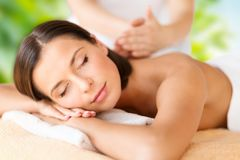 Close up of beautiful woman having massage at spa Royalty Free Stock Images