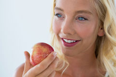 Close-up of beautiful woman holding red apple Royalty Free Stock Photo
