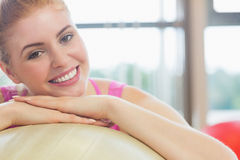 Close up of a beautiful woman leaning on exercise ball Royalty Free Stock Image