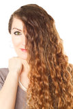 Close-up beautiful  woman with long curly hair Royalty Free Stock Images