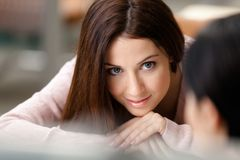 Close up of beautiful woman looking at another one Stock Photography