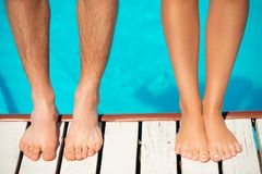Close-up of beautiful woman and man legs near by Stock Photos