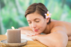 Close up of a beautiful woman on massage table Stock Photos
