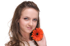 Close up of beautiful woman with  orange flower Stock Photography