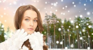 Close up of beautiful woman over winter forest royalty free stock photos