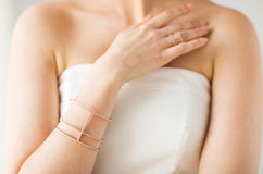 Close up of beautiful woman with ring and bracelet Royalty Free Stock Images