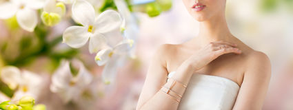 Close up of beautiful woman with ring and bracelet Royalty Free Stock Photo