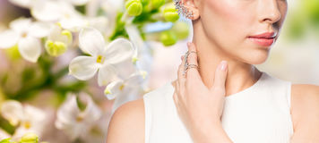 Close up of beautiful woman with ring and earring Stock Photo