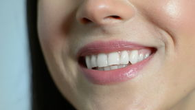 Close Up Of Beautiful Woman`s Mouth With Perfect Teeth As She Speaks stock video footage