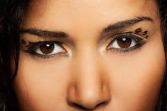 Close up on beautiful woman's tiger make up. Stock Photos