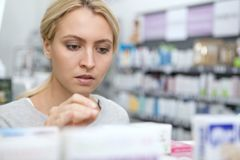 Beautiful woman shopping for medicine stock photography