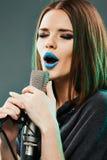 Close up beautiful woman singer portrait. Sound studio royalty free stock photography