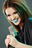 Close up beautiful woman singer portrait. Sound studio royalty free stock image