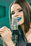 Close up beautiful woman singer portrait. Sound studio royalty free stock photo