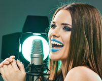 Close up beautiful woman singer portrait. Sound studio stock image