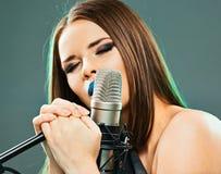 Close up beautiful woman singer portrait. Sound studio royalty free stock photos
