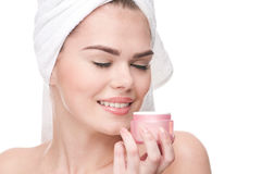 Close-up of beautiful woman smell cream. Royalty Free Stock Photo