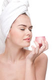 Close-up of beautiful woman smell cream. Royalty Free Stock Photos