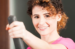 Close-up of beautiful woman smiling and exercising on stepper Royalty Free Stock Image