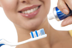 A close up of a beautiful woman with toothbrush. Foucs on the object Royalty Free Stock Photos