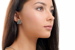 Close-up beautiful woman wearing earring Royalty Free Stock Image