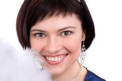 Close-up of beautiful woman with white feather Stock Images