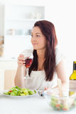 Close up of a beautiful women drinking wine Royalty Free Stock Image