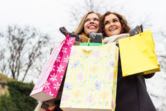 Close up of a beautiful women enjoying shopping Royalty Free Stock Images