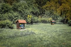 Close up of beautiful wooden bee house apiary in forest, isolated, collecting forest flower honey, cerknica, slovenia. Close up of beautiful wooden bee house stock images