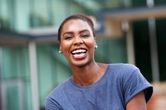 Close up beautiful young african american woman laughing outdoors royalty free stock photos