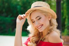 Close up of beautiful young blonde woman in a hat royalty free stock photo