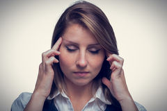 Close up of beautiful young businesswoman with headache Stock Photography