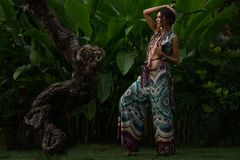 Beautiful young  woman on natural tropical background royalty free stock photo