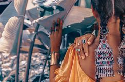 Close up of beautiful young fashionable woman with stylish boho accessories posing on natural tropical background stock photo