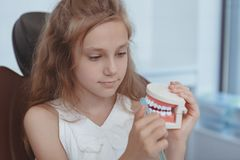 Beautiful young girl visiting dentist stock images
