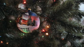 Close up of beautiful young lady hands decorate the Christmas tree with big ball stock video footage