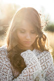Close up of a beautiful young lady model in field at sunset Royalty Free Stock Images